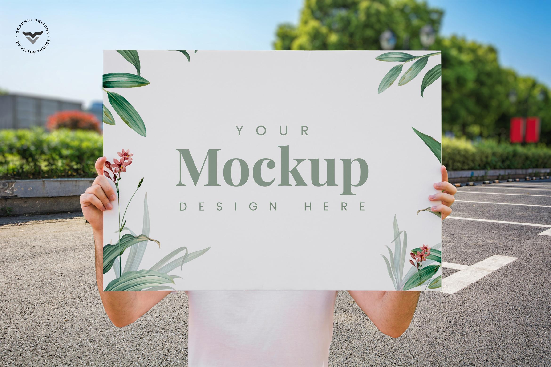 Man Presenting Poster Mockup